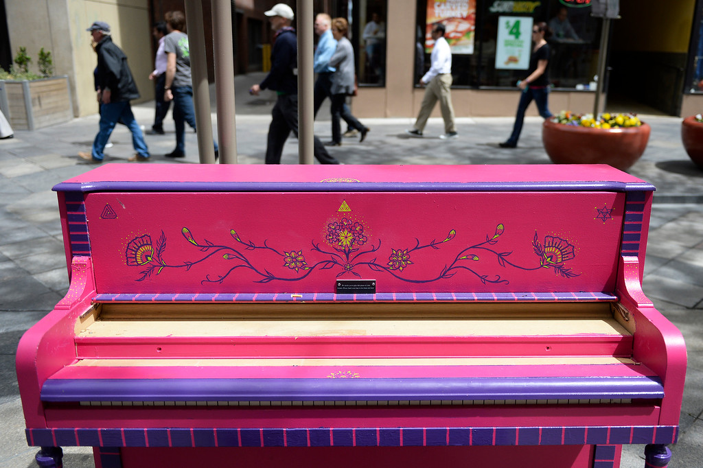 """. The pianos are back! The pianos are back! The \""""Your Keys to the City\"""", public art program pianos along the 16th Street Mall  have come out from winter hibernation in downtown Denver on Monday, May 09, 2016.  This colorful piano is located between Tremont Place  and Glenarm Place on the mall. (Photo by Cyrus McCrimmon/The Denver Post)"""