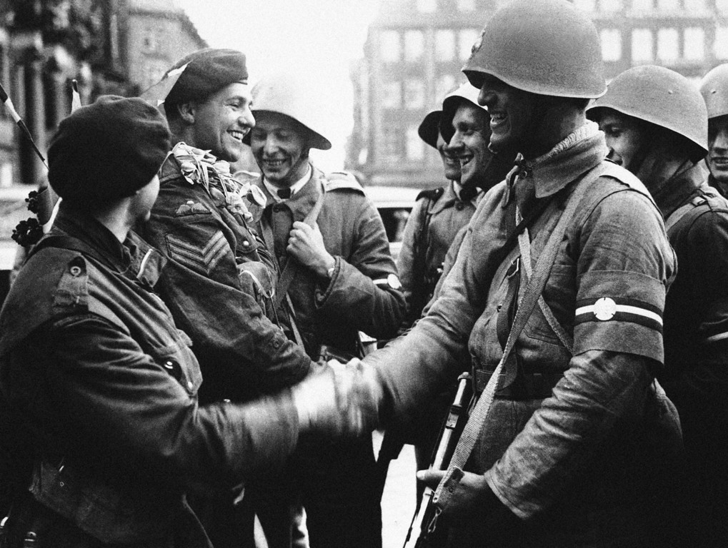 . The first British troops to land in Denmark were some of our airborne troops, fresh from their race across Germany to link up with the Russians. Welcome on the arrival of our airborne troops in the city in Copenhagen, May 7, 1945. (AP Photo)