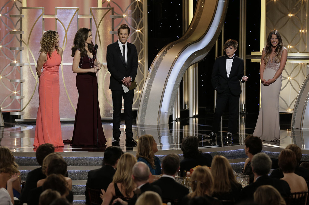 . In this handout photo provided by NBCUniversal, (L-R) Presenter Kyra Sedgwick, Host Tina Fey, Presenter Kevin Bacon, Host Amy Poehler and Miss Golden Globe Sosie Bacon speak onstage during the 71st Annual Golden Globe Award at The Beverly Hilton Hotel on January 12, 2014 in Beverly Hills, California.  (Photo by Paul Drinkwater/NBCUniversal via Getty Images)