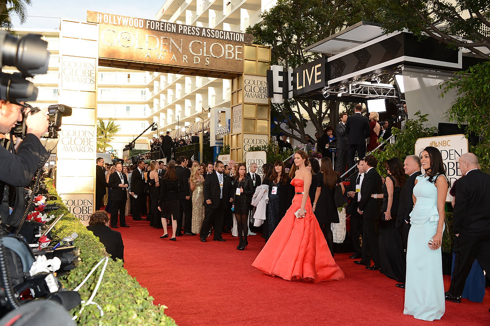 Description of . Actresses Jennifer Lawrence (C) and Rosario Dawson (far R) arrive at the 70th Annual Golden Globe Awards held at The Beverly Hilton Hotel on January 13, 2013 in Beverly Hills, California.  (Photo by Jason Merritt/Getty Images)