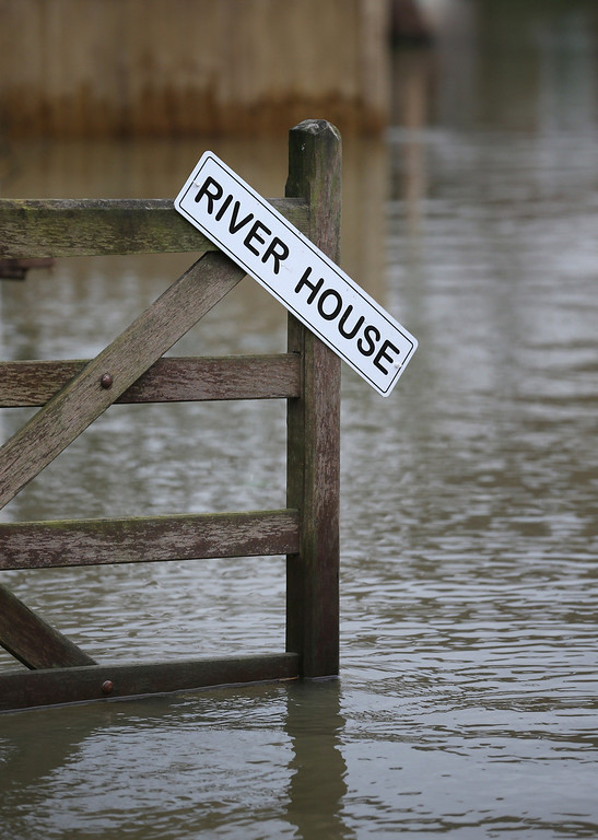 . The garden of a residential property called River House is flooded on February 12, 2014 in Wraysbury, England.The Environment Agency contiues to issue severe flood warnings for a number of areas on the river Thames in the commuter belt west of London. With heavier rains forecast for the coming week people are preparing for for the water levels to rise.  (Photo by Peter Macdiarmid/Getty Images)