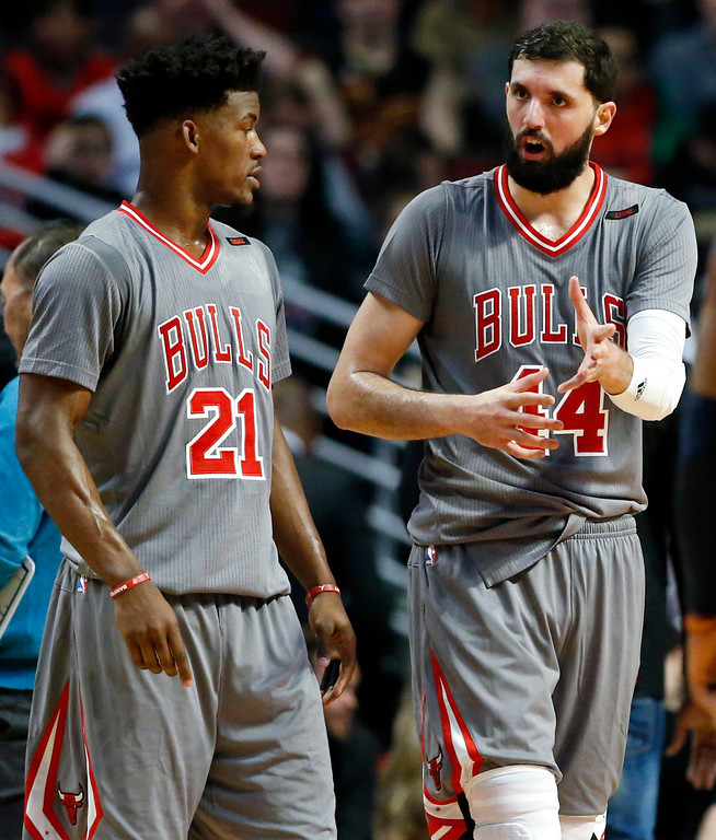 . Chicago Bulls forward Nikola Mirotic, right, talks with guard/forward Jimmy Butler during the second half of an NBA basketball game against the Cleveland Cavaliers Thursday, March 30, 2017, in Chicago. (AP Photo/Nam Y. Huh)