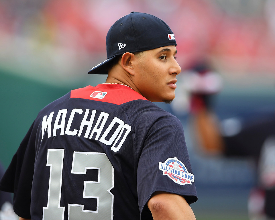 . American League, Baltimore Orioles shortstop Manny Machado looks over his shoulder as he walks onto the field before the Major League Baseball All-star Game, Tuesday, July 17, 2018 in Washington. (AP Photo/Nick Wass)