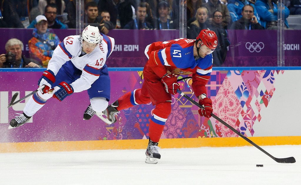 . Norway defenseman Henrik Odegaard defends as Russia forward Alexander Radulov takes an off balance shot in the second period of a men\'s ice hockey game at the 2014 Winter Olympics, Tuesday, Feb. 18, 2014, in Sochi, Russia. (AP Photo/Mark Humphrey)