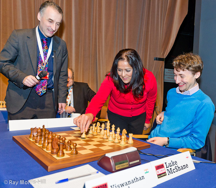 Member of Parliament Yasmin Qureshi makes the opening move in Luke's game against the Viswanathan Anand.