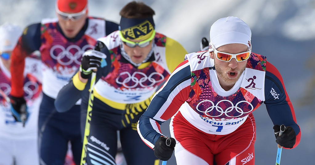 . Martin Johnsrud Sundby of Norway (R) in action during the Men\'s 15km + 15km Skiathlon competition in the Laura Cross Country Center at the Sochi 2014 Olympic Games, Krasnaya Polyana, Russia, 09 February 2014.  EPA/HENDRIK SCHMIDT