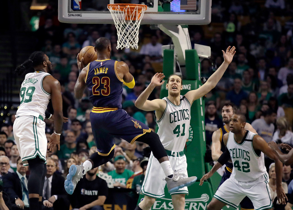 . Cleveland Cavaliers forward LeBron James (23) drives against Boston Celtics\' Jae Crowder (99), Kelly Olynyk (41) and center Al Horford (42) during the first quarter of Game 1 of the NBA basketball Eastern Conference finals, Wednesday, May 17, 2017, in Boston. (AP Photo/Charles Krupa)
