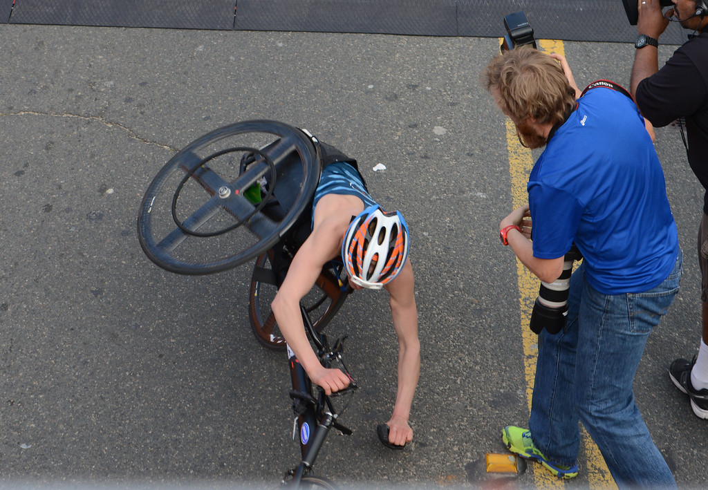 . 2014 ASICS LA Marathon women\'s wheelchair winner Susannah Scaroni crashes as she crosses the finish line in Santa Monica Calif, with a time of 1: 54: 54.   Sunday, March 9,  2014.   (Photo by Stephen Carr / Daily Breeze)