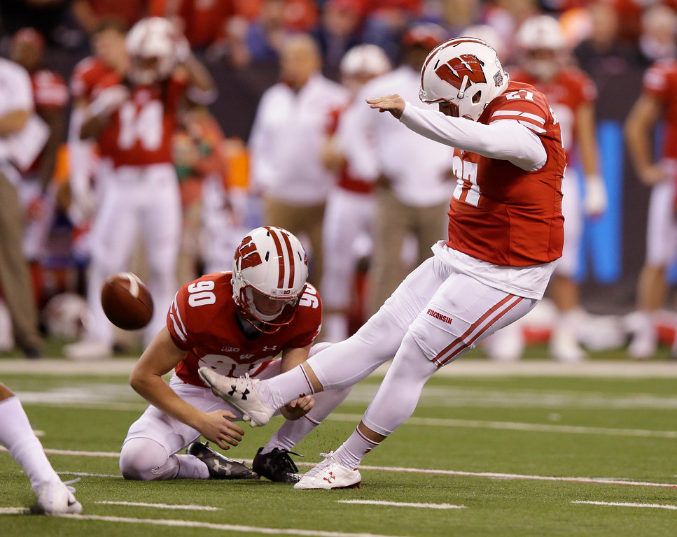 . Wisconsin place kicker Rafael Gaglianone (27) kicks a 28-yard field goal out of the hold of Connor Allen during the first half of the Big Ten championship NCAA college football game against Ohio State, Saturday, Dec. 2, 2017, in Indianapolis. (AP Photo/Michael Conroy)