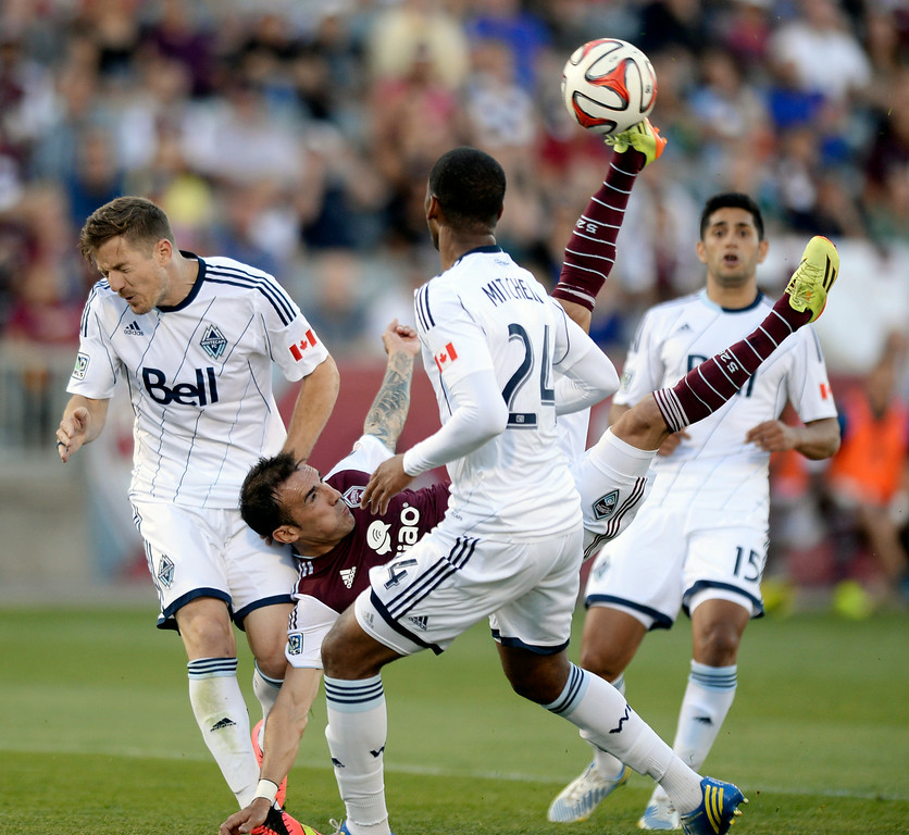 . COMMERCE CITY, CO - JUNE 28: Colorado forward Vicente Sanchez (7) tried to direct a bicycle kick between Vancouver defenders in the first half. The Colorado Rapids hosted the Vancouver Whitecaps at Dick\'s Sporting Goods Park Saturday night, June 28, 2014.  Photo by Karl Gehring/The Denver Post