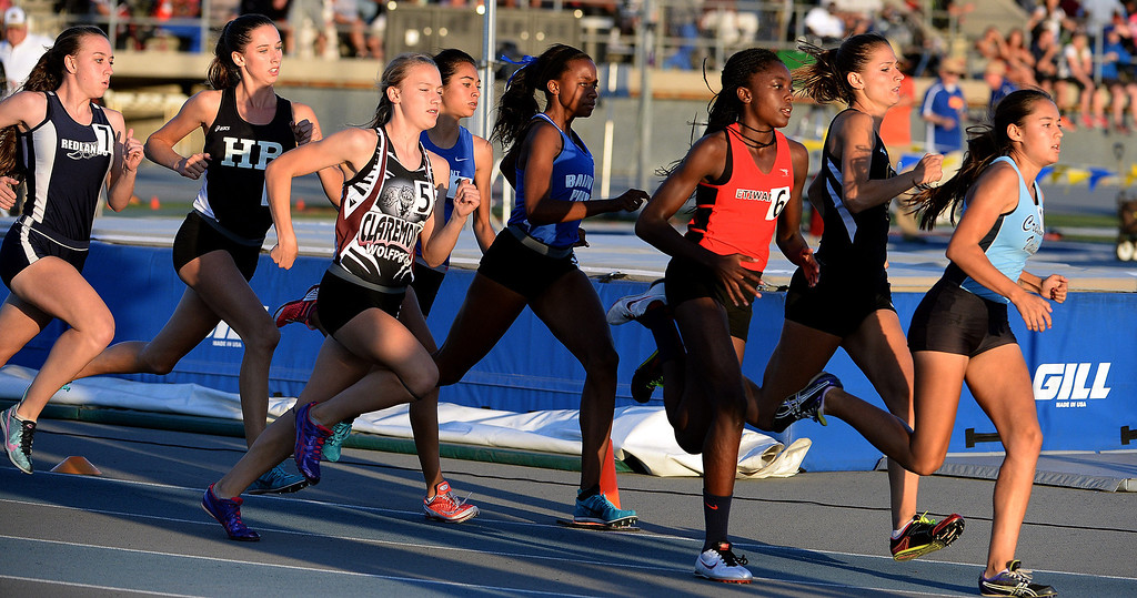 . Redland\'s Claire Crowley, left, Claremont\'s Annie Boos (5) along with Etiwanda\'s Jacquelyn Hill (6), Crescenta Valley\'s Megan Melnyk and Baldwin Park\'s Susie Garza, center, competes in the 800 meter run during the CIF-SS Masters Track and Field meet at Falcon Field on the campus of Cerritos College in Norwalk, Calif., on Friday, May 30, 2014.   (Keith Birmingham/Pasadena Star-News)