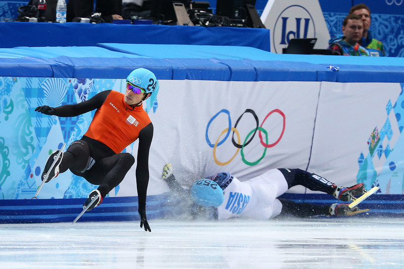 . Vladimir Grigorev (R) of Russia hits the wall while Freek van der Wart (L) of the Netherlands falls in the Short Track Men\'s 500m Quarterfinals on day fourteen of the 2014 Sochi Winter Olympics at Iceberg Skating Palace on February 21, 2014 in Sochi, Russia.  (Photo by Ryan Pierse/Getty Images)
