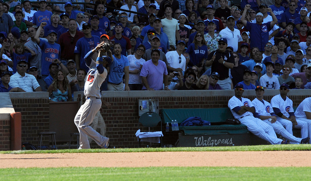 . Los Angeles Dodgers shortstop Hanley Ramirez catches a foul ball during the seventh inning  of a baseball game between the Chicago Cubs and the Los Angeles Dodgers Sunday Aug. 4, 2013 in Chicago, Ill. (AP Photo/Joe Raymond)