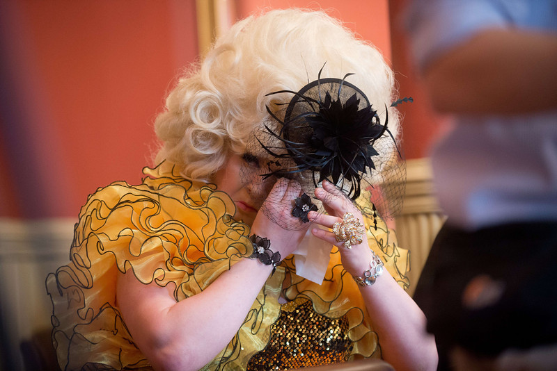 ". A guest reacts during the wedding of James Preston and Phil Robathan (not pictured) in Brighton, southern England, on March 29, 2014. Gay couples across England and Wales said ""I do\"" as a law legalizing same-sex marriage came into effect at midnight, the final stage in a long fight for equality.  (LEON NEAL/AFP/Getty Images)"