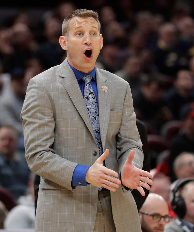 . Buffalo\'s head coach Nate Oats yells instructions to players during the second half of an NCAA college basketball championship game against Toledo in the Mid-American Conference tournament, Saturday, March 10, 2018, in Cleveland. Buffalo won 76-66. (AP Photo/Tony Dejak)
