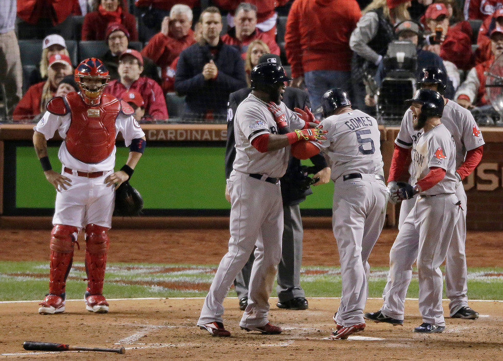 . Boston Red Sox\'s Jonny Gomes (5) celebrates at home after hitting a three-run home run during the sixth inning of Game 4 of baseball\'s World Series against the St. Louis Cardinals Sunday, Oct. 27, 2013, in St. Louis. (AP Photo/Charlie Riedel)