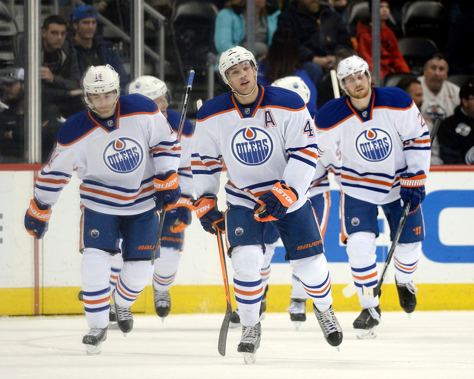 . DENVER, CO. - DECEMBER 19: Edmonton wing Taylor Hall (4) skated back to the bench after scoring the only goal of the first period Thursday night. The Colorado Avalanche hosted the Edmonton Oilers in an NHL game at the Pepsi Center Thursday night, December 19, 2013.  Photo By Karl Gehring/The Denver Post
