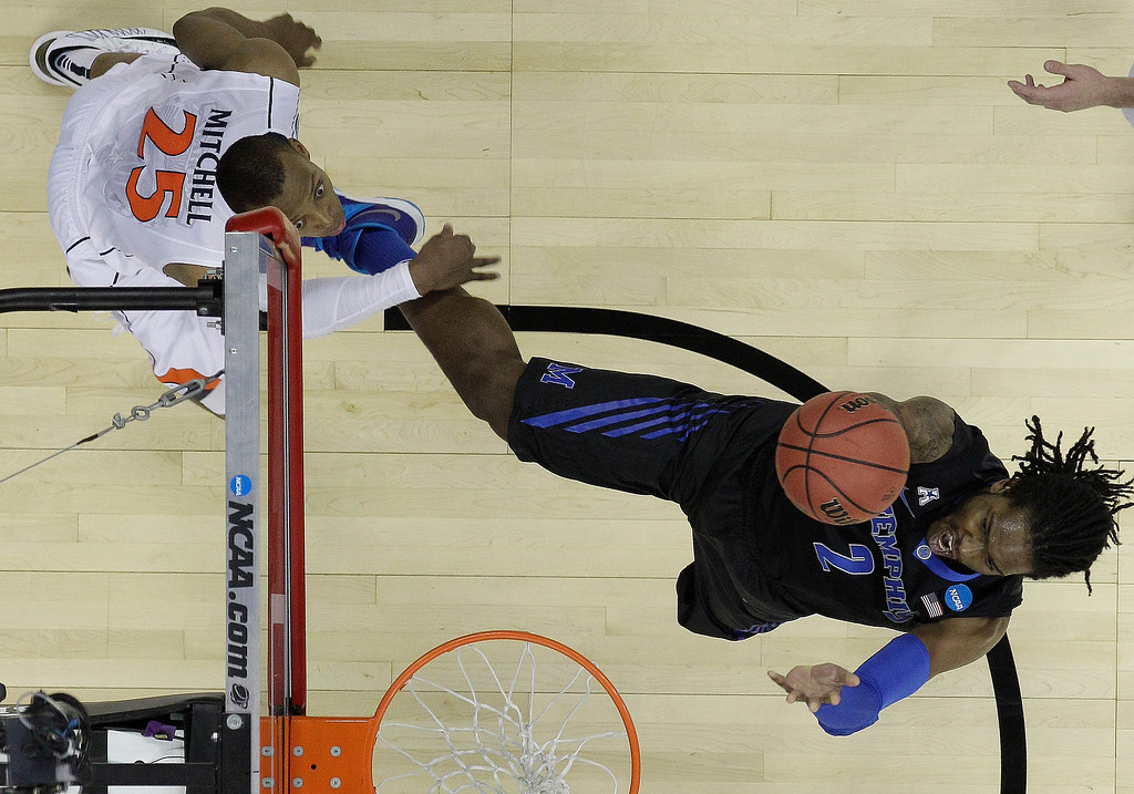. Memphis forward Shaq Goodwin (2) shoots against Virginia forward Akil Mitchell (25) during the first half of an NCAA college basketball third-round tournament game, Sunday, March 23, 2014, in Raleigh. (AP Photo/Chuck Burton)