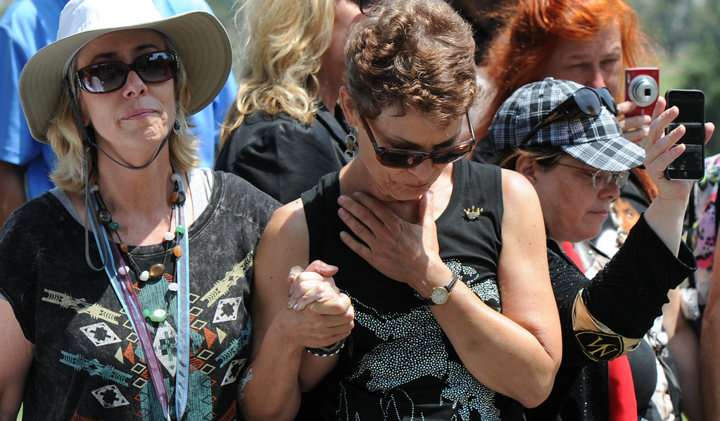 . Fans tear up during a prayer. Michael Jackson impersonators, and fans gathered at the Great Mausoleum at Forest Lawn Memorial Park in Glendale to honor Jackson on the 5th anniversary of his death.  Glendale, CA. 6/25/2014 (Photo by John McCoy Daily News)