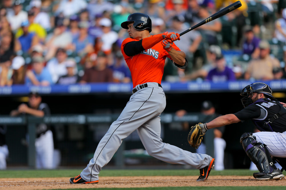 . Giancarlo Stanton #27 of the Miami Marlins hits an RBI single during the seventh inning against the Colorado Rockies at Coors Field on August 24, 2014 in Denver, Colorado. The Rockies defeated the Marlins 7-4. (Photo by Justin Edmonds/Getty Images)