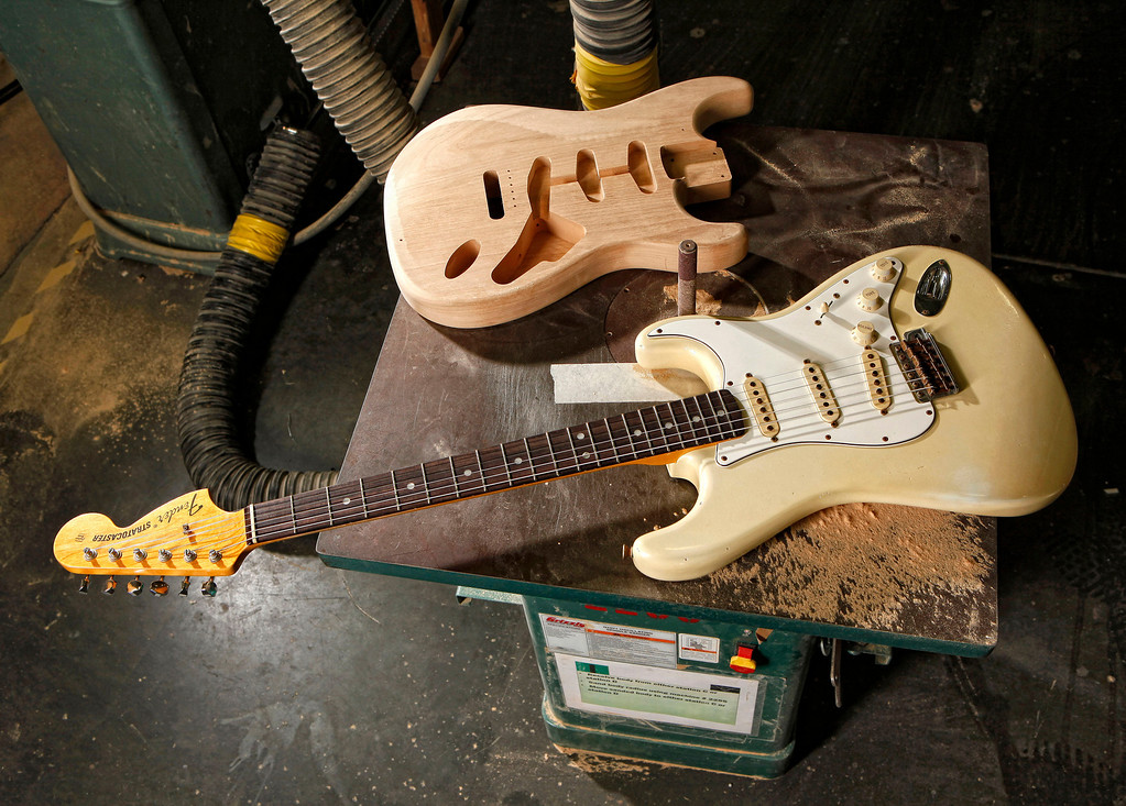 . A brand new Fender Stratocaster is shown on a routing machine in the Custom Shop at the Fender factory in Corona, Calif. on Friday, Nov. 19, 2010. The iconic instrument is on display at the Smithsonian National Museum of American History. (AP Photo/Matt York)