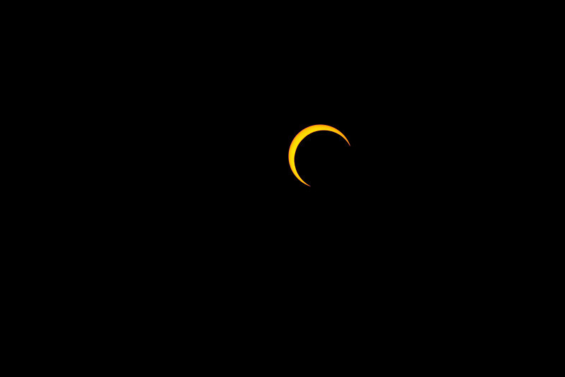Cresent sun, partially eclipsed by the moon. Taken in Redding, California. This is uncropped.