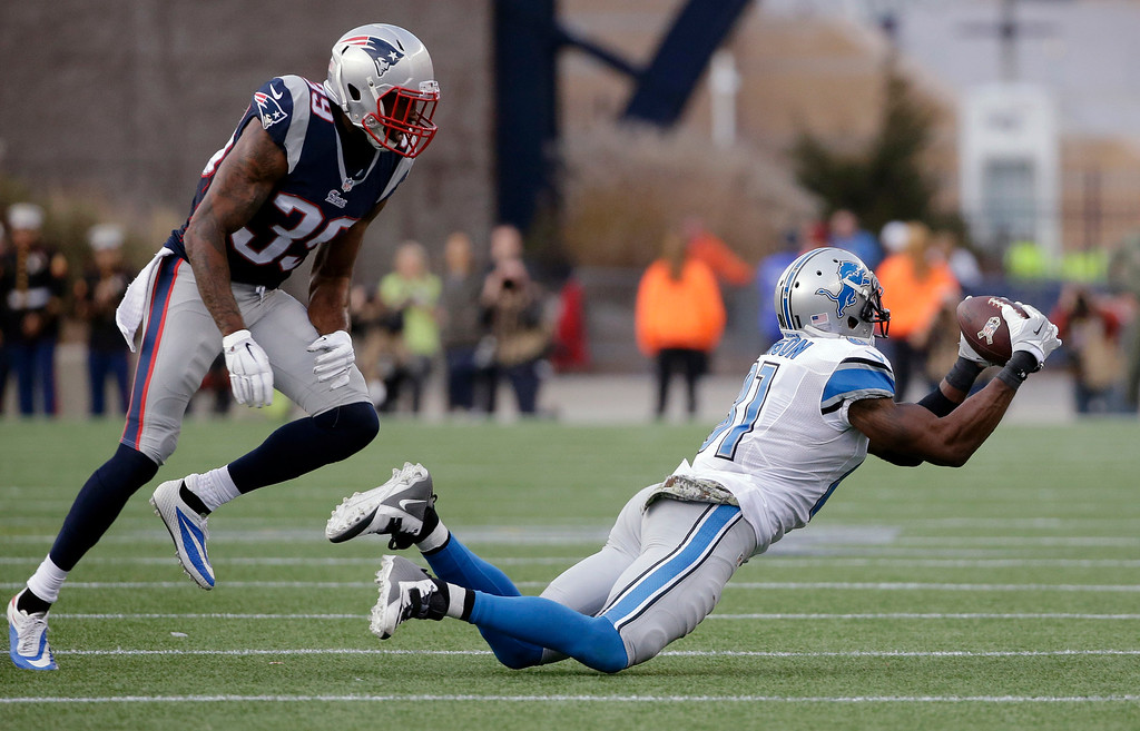 . Detroit Lions wide receiver Calvin Johnson (81) catches a pass in front of New England Patriots cornerback Brandon Browner (39) in the second half of an NFL football game Sunday, Nov. 23, 2014, in Foxborough, Mass. (AP Photo/Steven Senne)