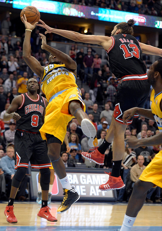 . Denver Nuggets power forward Kenneth Faried (35) gets fouled by Chicago Bulls center Joakim Noah (13) during the first quarter November 21, 2013 at Pepsi Center. (Photo by John Leyba/The Denver Post)