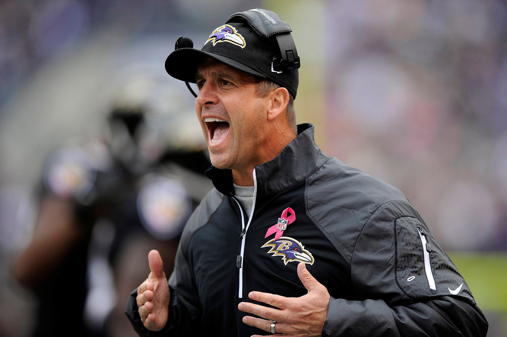 . Baltimore Ravens head coach John Harbaugh yells instructions to the field during the first half of a NFL football game against the Green Bay Packers in Baltimore, Sunday, Oct. 13, 2013. (AP Photo/Nick Wass)