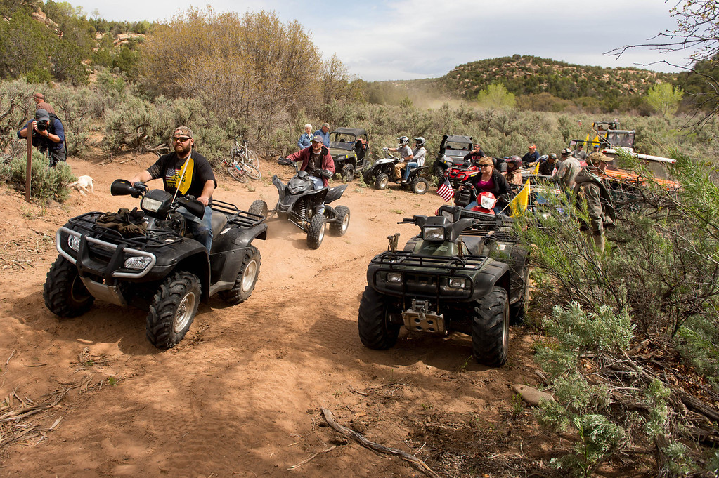 . Motorized vehicles cross into a restricted area of Recapture Canyon, which has been closed to motorized use since 2007, after a call to action by San Juan County Commissioner Phil Lyman. Saturday May 10, 2014 north of Blanding. (Photo by Trent Nelson/The Salt Lake Tribune)