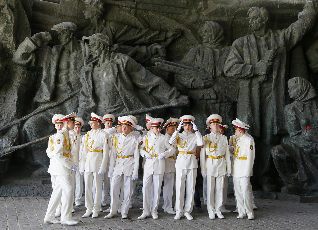 . Cadets of the Ukrainian Military academy preparing to celebrate the anniversary of victory over the Nazis at a memorial to World War II veterans in a memorial park in Kiev, Ukraine,  Thursday, May 9, 2013. Ukrainians continue to celebrate the World War II anniversary and Victory Day on May 9 as a national holiday. (AP Photo/Efrem Lukatsky)