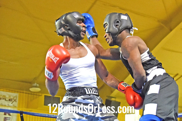 Bout 13 = Main Event Elmer Dennis, Red Gloves, Zelma George/Empire Boxing -vs- Branson Price, Blue Gloves, Unattached. 152 lbs, Novice, 2 Min. Rds.