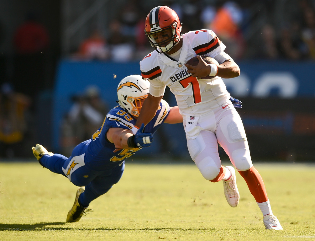. Los Angeles Chargers defensive end Joey Bosa, left, dives for Cleveland Browns quarterback DeShone Kizer during the first half of an NFL football game Sunday, Dec. 3, 2017, in Carson, Calif. (AP Photo/Kelvin Kuo)