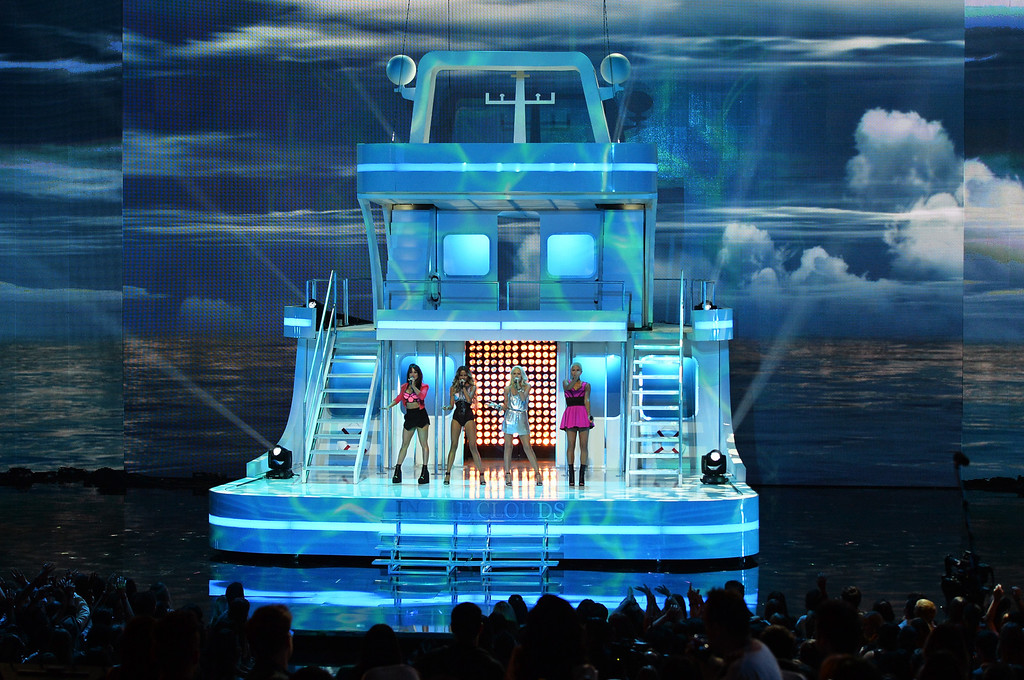 . LOS ANGELES, CA - MAY 01:  (L-R) Singers Natasha Slayton, Emmalyn Estrada, Lauren Bennett, and Paula Van Oppen of G.R.L. perform onstage during the 2014 iHeartRadio Music Awards held at The Shrine Auditorium on May 1, 2014 in Los Angeles, California. iHeartRadio Music Awards are being broadcast live on NBC.  (Photo by Kevin Winter/Getty Images for Clear Channel)