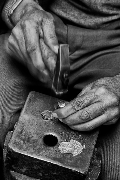 Metal worker making the popular hand of Fatima, said to help against the evil eye.