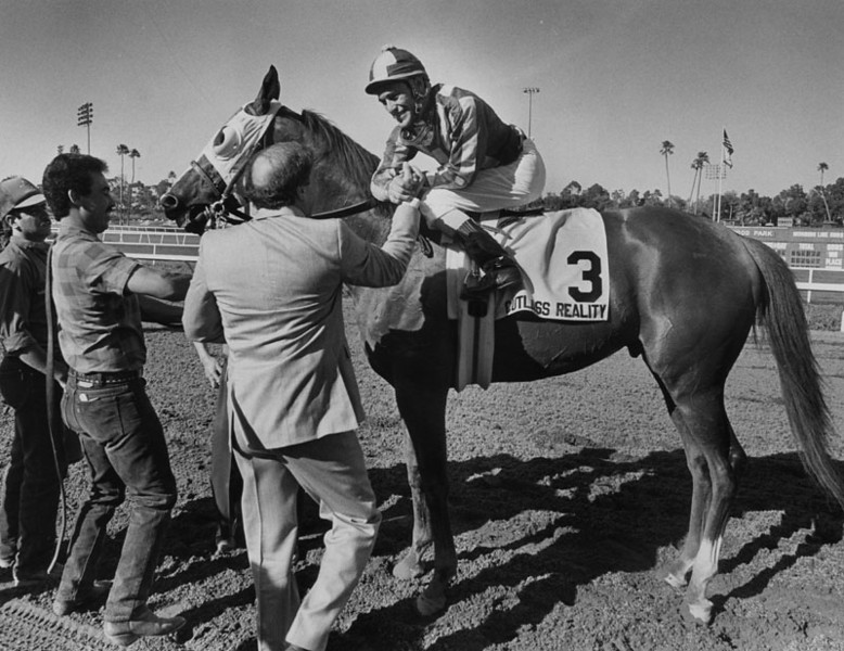 . Jockey Gary Stevens is congratulated after steering Cutlass Reality to victory in the Gold Cup at Hollywood Park.  Photo dated June 27, 1988.   (Los Angeles Public Library)