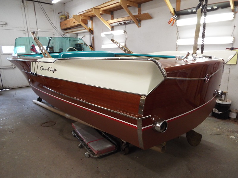 Port rear view of the new transom guard and the exhaust pipe trim installed.