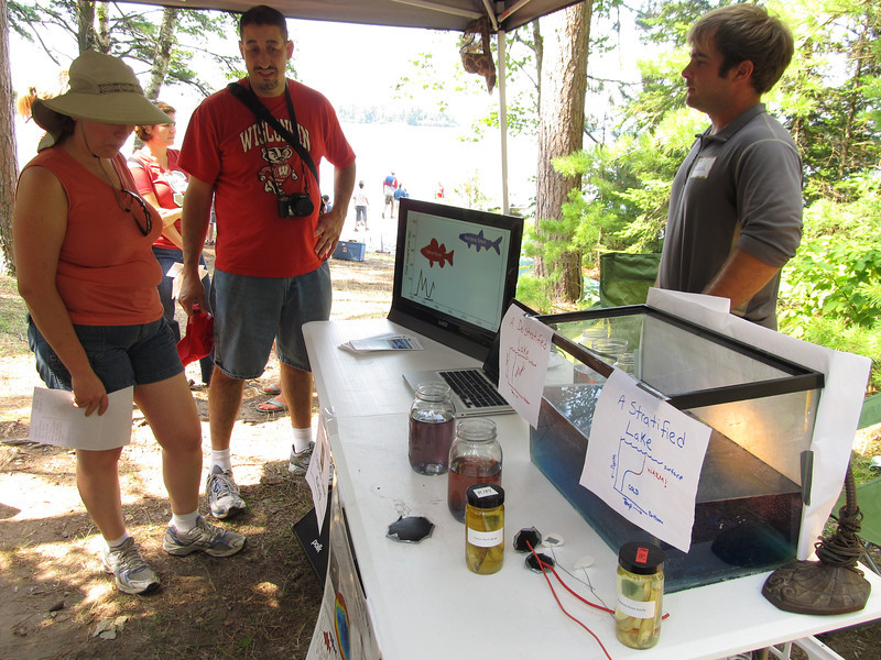 The Crystal Lake Mixing Project held demonstrations so people could visualize how a lake is mixed. Samples of invasive Smelt were also on display.