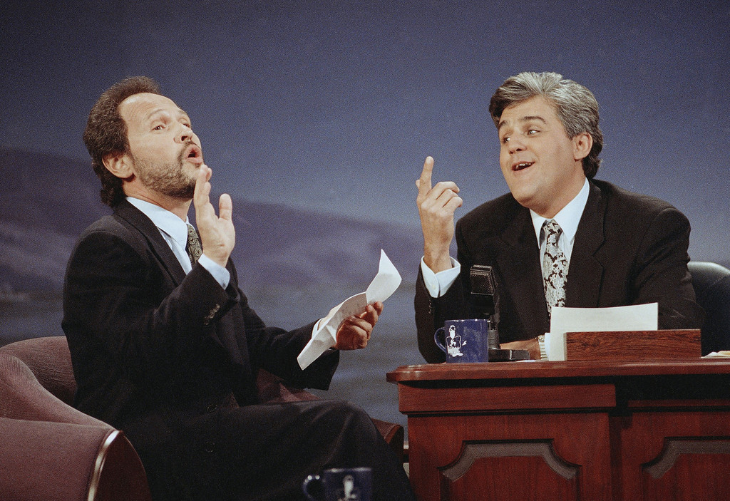 """. Actor/comedian Billy Crystal, left, serenades \""""Tonight Show\"""" host Jay Leno with \""""Dear Mr. Leno\"""" during the inauguration of \""""The Tonight Show With Jay Leno\"""" at NBC Studios in Burbank, May 26, 1992. The song Crystal sang was a parody of Bette Midler\'s ode to Carson on his penultimate show last week. Crystal was Leno\'s first guest. (AP Photo/Craig Fujii)"""