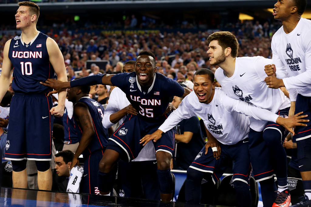 . ARLINGTON, TX - APRIL 05:  The Connecticut Huskies bench reacts during the NCAA Men\'s Final Four Semifinal against the Florida Gators at AT&T Stadium on April 5, 2014 in Arlington, Texas.  (Photo by Ronald Martinez/Getty Images)