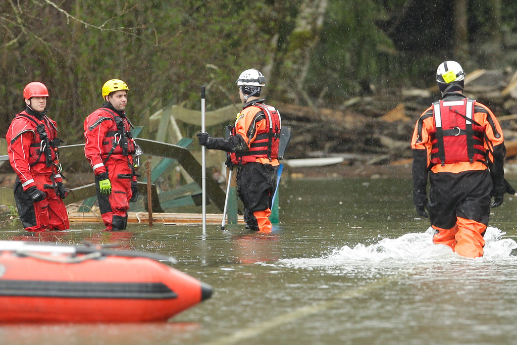 . Search and rescue teams continue to work on March 27, 2014 in Oso, Washington. A massive mudslide killed at least twenty-five and left many missing. (Photo by Ted S. Warren-Pool/Getty Images)