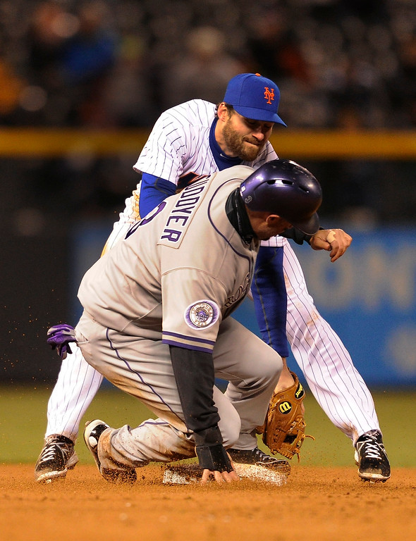 . DENVER, CO. - APRIL 16:  Rockies baserunner Michael Cuddyer was tagged out by Danniel Murphy attempting to steal second base in the fourth inning. The Colorado Rockies hosted the New York Mets in the second game of a doubleheader Tuesday night, April 16, 2013. Monday night\'s game was snowed out at Coors Field.  Photo By Karl Gehring/The Denver Post)