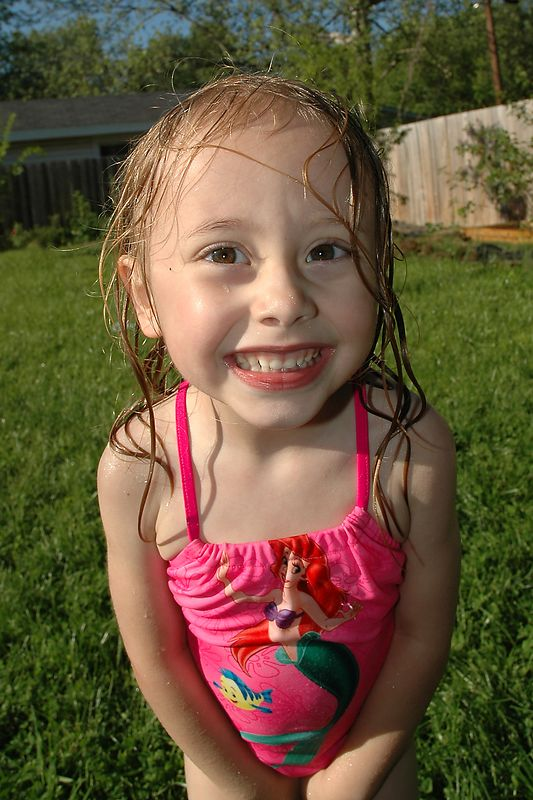 Mae takes a break from the sprinkler.