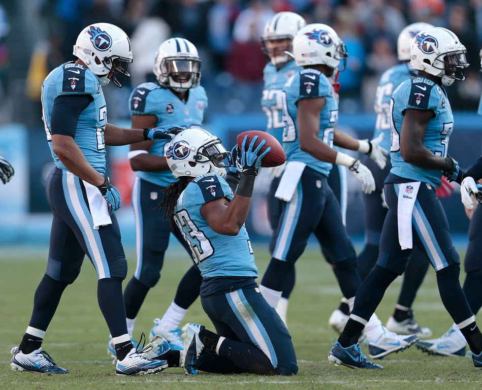 . Tennessee Titans safety Michael Griffin (33) celebrates after intercepting a pass against the Houston Texans in the final minutes of the fourth quarter to seal a 16-10 win for the Titans in an NFL football game on Sunday, Dec. 29, 2013, in Nashville, Tenn. (AP Photo/Wade Payne)