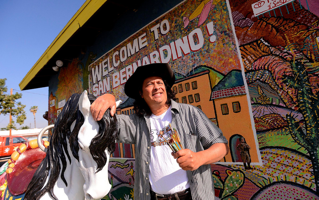 . Artist Phil Ye, 58, of Running Springs, stands in front of a mural he\'s been painting on the side of the McDonald\'s Museum for over a year in San Bernardino May 9, 2013.  (Photo by Gabriel Luis Acosta/The Sun)