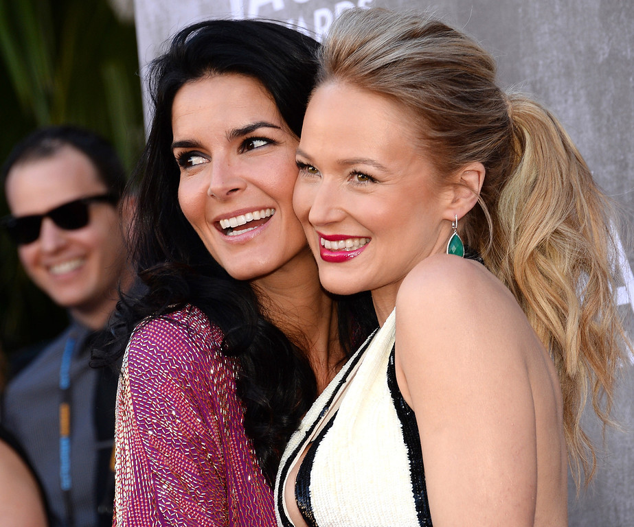. Angie Harmon, left, and Jewel arrive at the 49th annual Academy of Country Music Awards at the MGM Grand Garden Arena on Sunday, April 6, 2014, in Las Vegas. (Photo by Al Powers/Powers Imagery/Invision/AP)
