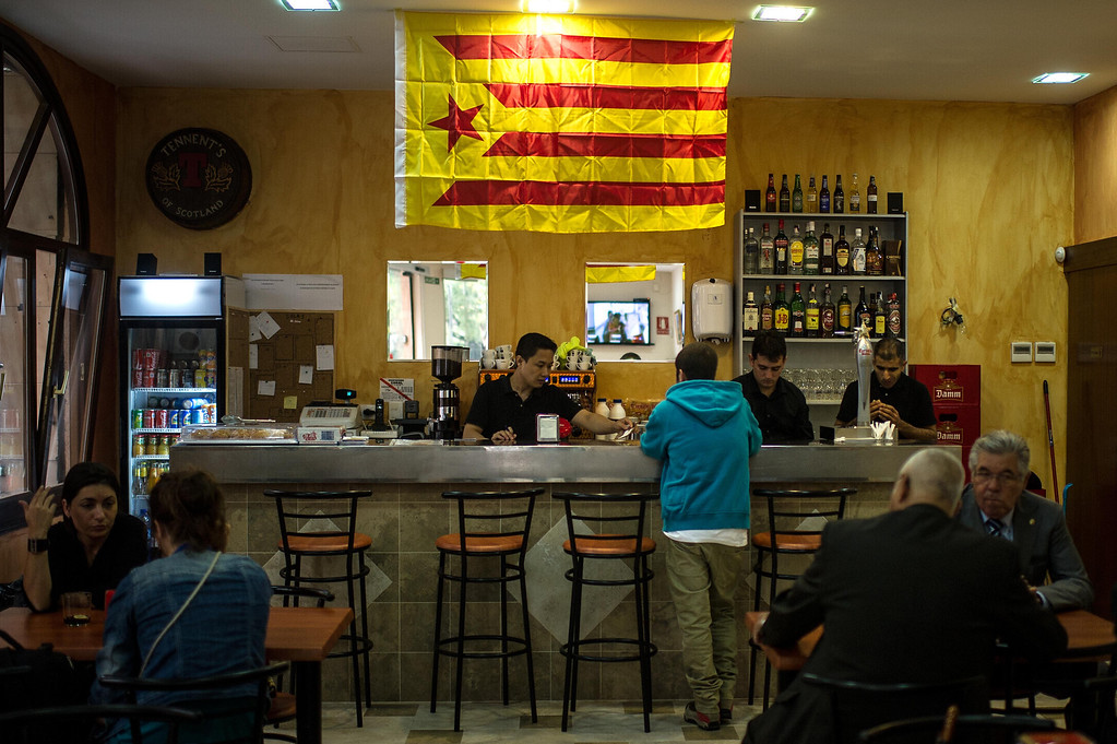 . BARCELONA, SPAIN - SEPTEMBER 11:  A Catalonia Pro-Independence flag hangs at a bar during The National Day of Catalonia on September 11, 2013 in Barcelona, Spain. Thousands of Catalans celebrating the \'Diada Nacional\' are holding demostrations to demand the right to hold a self-determination referendum next year. (Photo by David Ramos/Getty Images)