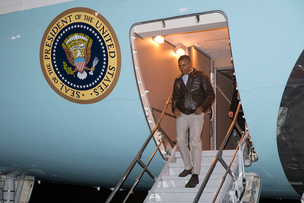 . President Barack Obama steps off Air Force One after arriving at Bagram Air Field for an unannounced visit, on Sunday, May 25, 2014, north of Kabul, Afghanistan. (AP Photo/ Evan Vucci)