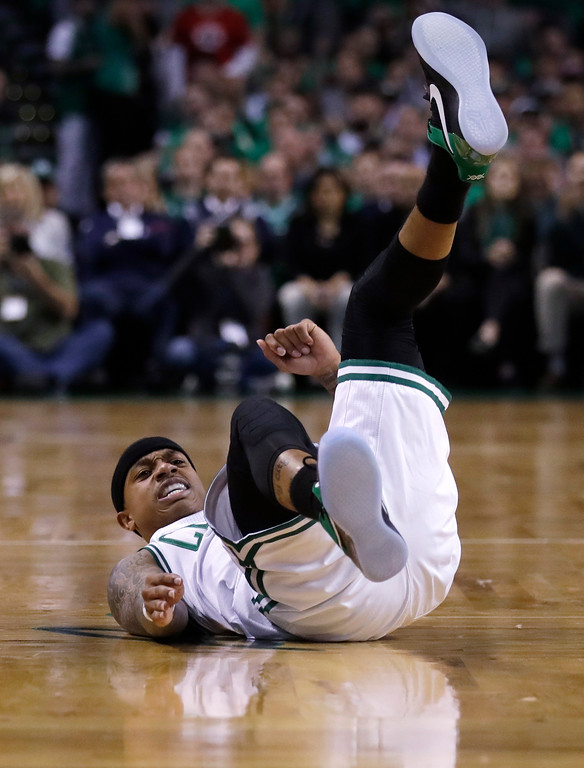. Boston Celtics guard Isaiah Thomas (4) lands on the floor during the first half of Game 7 of an NBA basketball second-round playoff series Boston, Monday, May 15, 2017. (AP Photo/Charles Krupa)
