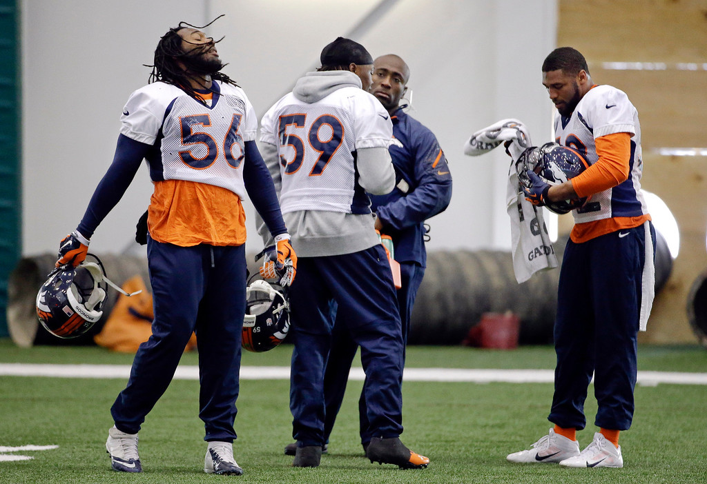 . Denver Broncos linebackers Nate Irving (56), Danny Trevathan (59) and Wesley Woodyard, right, take a break between drills during practice Thursday, Jan. 30, 2014, in Florham Park, N.J. The Broncos are scheduled to play the Seattle Seahawks in the NFL Super Bowl XLVIII football game Sunday, Feb. 2, in East Rutherford, N.J. (AP Photo)